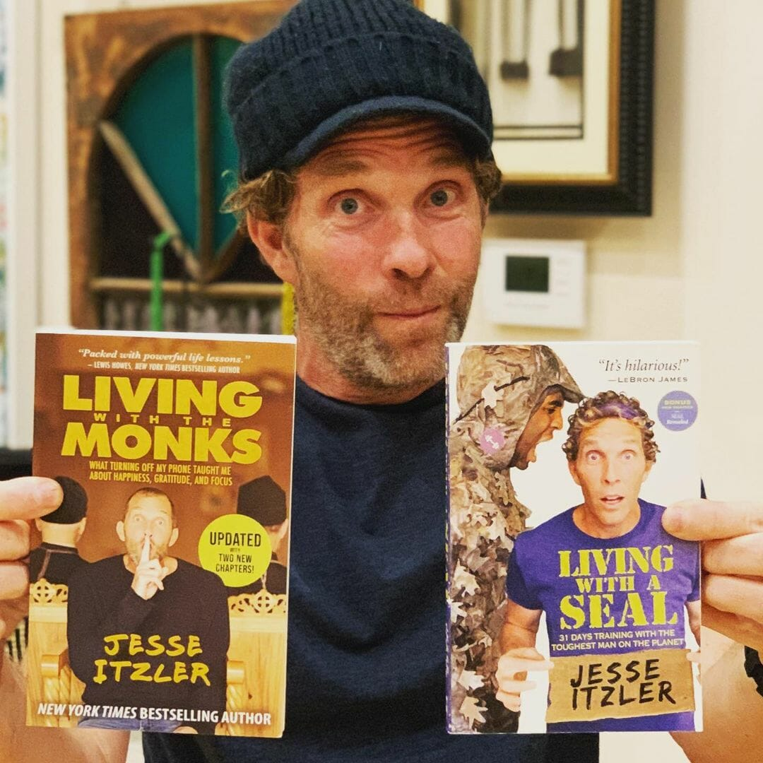 Jesse Itzler With His Two Books